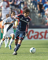 New England Revolution midfielder Juan Carlos Toja (7) brings the ball forward.  In a Major League Soccer (MLS) match, the New England Revolution (blue) defeated LA Galaxy (white), 5-0, at Gillette Stadium on June 2, 2013.