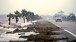Traffic battles the wind and sea spray from Hurricane Kate on the causeway between Eastpoint and Apalachicola, Florida  November 21, 1985.  Kate, a late November Hurricane,  was latest forming Atlantic hurricane on record at the time and was the second for the area following Hurricane Elena two months earlier.