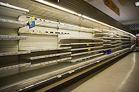 The bare shelves of the dairy department of a Gristede's supermarket in the Chelsea neighborhood of New York that just reopened after power was restored, seen on Saturday, November 3, 2012.  Power has been restored to many neighborhoods but restaurants and supermarkets had to throw out thousands of dollars of spoiled inventory because of the power outage from Hurricane Sandy. (© Richard B. Levine)