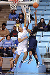 02 January 2015: ETSU's Destiny Mitchell (41) shoots over North Carolina's Hillary Summers (30). The University of North Carolina Tar Heels hosted the East Tennessee State University Buccaneers at Carmichael Arena in Chapel Hill, North Carolina in a 2014-15 NCAA Division I Women's Basketball game. UNC won the game 95-62.