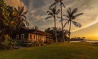 Sunset colors reflect on the Eva Parker Woods Cottage, Mauna Lani Bay, Big Island of Hawai'i.