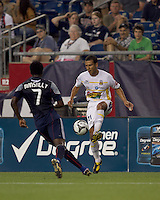 Monarcas Morelia midfielder Jaime Lozano (21) passes the ball as New England Revolution forward Kenny Mansally (7) closes. The New England Revolution defeated Monarcas Morelia in SuperLiga 2010 group stage match, 1-0, at Gillette Stadium on July 20, 2010.