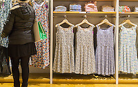 Shoppers in the Uniqlo store on Fifth Avenue in New York on Thursday, March 24, 2016 browse the merchandise in the collaboration between Uniqlo and Liberty London, a company known mostly for its distinctive floral patterned fashions. (© Richard B. Levine)
