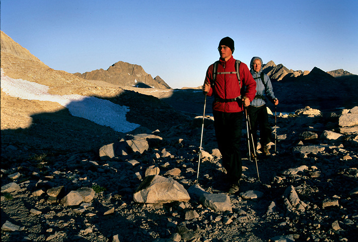 Muir Pass at Sunrise. Two hikers enjoy one of the most popular passes on the John Muir Trail in solitude.
