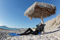 QT41706-D. woman enjoys a siesta between dives at Cabo Pulmo, Baja, Mexico, Sea of Cortez, Pacific Ocean.<br /> Photo Copyright &copy; Brandon Cole. All rights reserved worldwide.  www.brandoncole.com