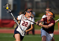 Caroline McTiernan (22) of Virginia tries to get past  Christina Patten (3) of Virginia Tech during the first round of the ACC Women's Lacrosse Championship in College Park, MD.  Virginia defeated Virginia Tech, 18-6.