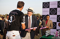 Dr. Lachlan Strahan, Australian High Commissioner to India, presents a gift to a polo player from the Western Australia Polo Team after a close match for the Argyle Pink Diamond Cup, organised as part of the 2013 Oz Fest in the Rajasthan Polo Club grounds in Jaipur, Rajasthan, India on 10th January 2013. Photo by Suzanne Lee