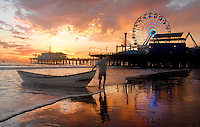 "Robert Gallagher brings the 'Shark Boat"" ashore at Santa Monica beach amid the sunset on Wednesday, Sept 29, 2010."