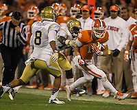 The eighth ranked Clemson Tigers defeat the Georgia Tech Yellow Jackets at Death Valley 55-31 in an ACC matchup.  Clemson Tigers wide receiver Adam Humphries (13), Georgia Tech Yellow Jackets defensive back Jemea Thomas (14), Georgia Tech Yellow Jackets cornerback Louis Young (8)