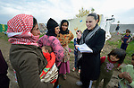 Sabeen Abdulsater (right), project officer for the Bekaa Valley for International Orthodox Christian Charities, interviews women refugees from Syria in the village of Jeb Jennine, Lebanon.