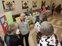 NWA Democrat-Gazette/ANDY SHUPE<br /> Cheryl Bell (center), a licensed professional spiritual practitioner, speaks Saturday, March 19, 2016, with visitors about the Northwest Arkansas Center for Spiritual Living during Interfaith Harmony Day at St. Paul's Episcopal Church in Fayetteville. Representatives from many local faiths shared information about their faiths and answered questions for visitors.