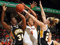Dec. 18, 2010; Charlottesville, VA, USA; Virginia Cavaliers center Simone Egwu (4) is defended by UMBC Retrievers center Topé Obajolu (34) and UMBC Retrievers guard Michele Brokans (21) during the game at the John Paul Jones Arena. Virginia won 61-46. Mandatory Credit: Andrew Shurtleff-U