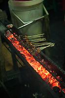 Satay sticks cooking.<br /> Sanur, Bali