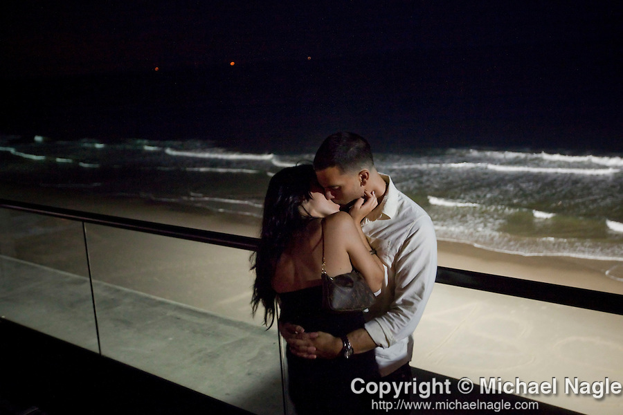 LONG BRANCH, NJ - JUNE 06, 2009:  Mike Barone and Cristina Cruz kiss on the terrace at Avenue Nuit overlooking the beach on June 6, 2009 in Long Branch, NJ.  (PHOTOGRAPH BY MICHAEL NAGLE)