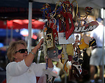 Maria McClatchy decorates her tailgating spoti n the Grove at the University of Mississippi in Oxford, Miss. on Saturday, September 4, 2010. Mississippi hosts Jacksonville State in NCAA college football action. (AP Photo/Oxford Eagle, Bruce Newman)