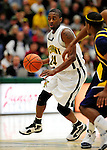 13 December 2009: University of Vermont Catamounts' guard Maurice Joseph, a Senior from Montreal, Quebec, in action against the Quinnipiac University Bobcats at Patrick Gymnasium in Burlington, Vermont. The Catamounts defeated the visiting Bobcats 80-77 to mark the Cats' season home opener with a win. Mandatory Credit: Ed Wolfstein Photo