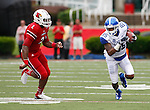 Senior wide receiver Gene McCaskill runs with the ball during the first half of the UK vs. UL football game at Papa John's Cardinal Stadium in Louisville, Ky., on Sunday, September 2, 2012. Photo by Tessa Lighty | Staff
