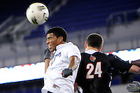 Jossimar Sanchez (44) of the Connecticut Huskies heads the ball over Austin Berry (24) of the Louisville Cardinals. Connecticut defeated Louisville 1-0 during the first semifinal match of the Big East Men's Soccer Championships at Red Bull Arena in Harrison, NJ, on November 11, 2011.