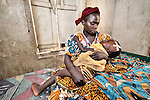A woman cares for her daughter with malaria in a hospital in the remote village of Minga that was started by Methodist missionaries and is today operated jointly by the United Methodist Church and the Congolese government.