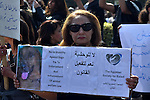 Egyptians hold placards during demonstration against killing Al-ahram's Dog at Al Jazeera square in Cairo, Egypt on February 28, 2015. Photo by Amr Sayed
