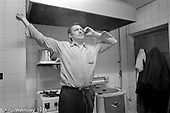 In the kitchen, George Shields stretching, Scotland Road Free School, Liverpool  1971.  Also known as the Scotland Road or Scottie Road Free School it was founded and run by two teachers, John Ord and Bill Murphy (if I've got these names wrong, please tell me!) who worked with truanting kids and provided somewhere to go and things to do.  They begged and borrowed an old building, desks, books and an old ambulance for trips.