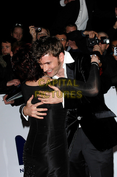 SHARRON OSBOURNE, DAVID TENNANT.National Television Awards 2007.Royal Albert Hall.31st October 2007 London, England.half length hugging.CAP/PL.©Phil Loftus/Capital Pictures