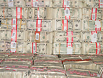 Bundles of U.S. five dollar bills
