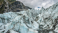 Ice waves and Serac waterfall on Fox Glacier, Westland National Park, West Coast, World Heritage Area, South Westland, New Zealand