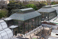 Jardin des Plantes, Museum National d'Histoire Naturelle, Paris, France. Aerial view of the Jardin des Plantes showing the Glasshouses in the afternoon light, left to right: Incubators, restored 1995-97, Paul Chemetov and Borja Huidobro; Plant History Glasshouse (formerly Australian Glasshouse), 1830s, Rohault de Fleury; New Caledonia Glasshouse (formerly Mexican Hothouse), 1834, Charles Rohault de Fleury; Tropical Rainforest Glasshouse (formerly Le Jardin d'Hiver or Winter Gardens), 1936, René Berger,  and alongside it the Desert and Arid Land Glasshouse, 1930s.