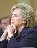 Former United States Secretary of State Hillary Rodham Clinton, a candidate for the 2016 Democratic Party nomination for President of the United States, listens to the Member's opening statements  as she testfies before the US House Select Committee on Benghazi on Capitol Hill in Washington, DC on Thursday, October 22, 2015.<br /> Credit: Ron Sachs / CNP
