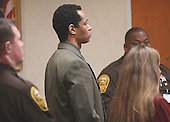 Sniper suspect John Allen Muhammad stands as a verdict of guilty on all four counts is read in courtroom 10 at the Virginia Beach Circuit Court in Virginia Beach, Virginia on November 17, 2003.  Muhammad was found guilty of capitol murder, terrorism, conspiracy and a firearms violation. <br /> Credit: Dave Ellis - Pool via CNP