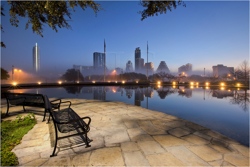 This bench has a wonderful view of downtown Austin, Texas, and the Austin skyline. On this morning before sunrise, looking across Lady Bird Lake, a low fog rested among the buildings and architecture of Austin.