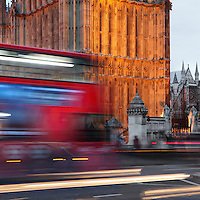 London bus against Palace of Westminster and Westminster Abbey (right) at twilight, London, UK. Picture by Manuel Cohen