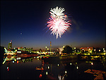Fireworks over the St. Joseph River, South Bend, Indiana..Photo by Matt Cashore..Use of this image prohibited without authorization and/or compensation..To contact Matt Cashore:.574.220.7288.574.233.6124.cashore1@michiana.org.www.mattcashore.com