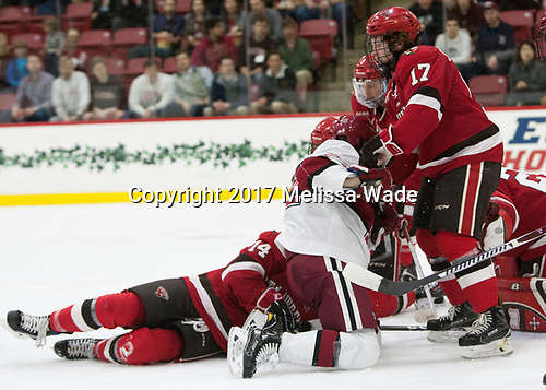 Devin Tringale (Harvard - 22), Drew Smolcynski (SLU - 17) - The Harvard University Crimson defeated the St. Lawrence University Saints 6-3 (EN) to clinch the ECAC playoffs first seed and a share in the regular season championship on senior night, Saturday, February 25, 2017, at Bright-Landry Hockey Center in Boston, Massachusetts.