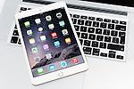 Apple iPad Mini 3 tablet on MacBook laptop computer