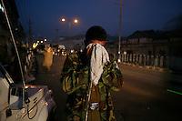 475.9.Årets reportasje utland.I KONFLIKTENS HJERTE /  THE HEART OF THE CONFLICT..En politsjef får sMake sin egen medisin når  tåregass ment for demonstranter blåser tilbake mot en politipost. Politi og ungdommer braket sammen etter at separatistlederen Yaseen Malik ble arrestert. Srinagar, Kashmir, India...A police commander gets a taste of his own medicine as tear gas drifts over a police position. Police and paramilitary clashed with stone throwing youth following the arrest of  separatist leader Yasin Malik. Srinagar, Kashmir, India...DIGITALT.02112008.SRINAGAR,INDIA