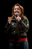 Ramstein AFB, Germany - December 16, 2008 -- Comedian Kathleen Madigan performs for service members during the 2008 USO Holiday Tour stop at Ramstein Air Force Base, Germany on Tuesday, December 16, 2008.  Tour host United States Navy Admiral Mike Mullen, chairman of the Joint Chiefs of Staff and his wife Deborah were joined by, along with Madigan,  comedians John Bowman and Lewis Black; actress Tichina Arnold; American Idol contestant and country musician Kellie Pickler and Grammy award winning musician Kid Rock on the tour bringing joy to service members and their families stationed overseas..Credit: Chad J. McNeeley - DoD via CNP