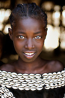 Kara from Tsemey tribe wearing conch shells   <br /> Kuka Village, Omo Valley, Ethiopia 2006