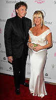 BEVERLY HILLS, CA, USA - OCTOBER 11: Barry Manilow, Suzanne Somers arrive at the 2014 Carousel Of Hope Ball held at the Beverly Hilton Hotel on October 11, 2014 in Beverly Hills, California, United States. (Photo by Celebrity Monitor)