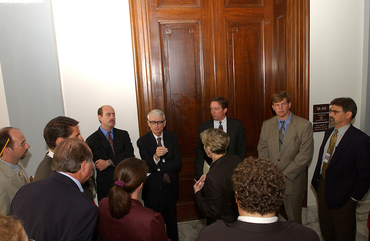 1pressgallery071001 -- Members of the Standing Committee's for the reporters and photographers wait for Senator Christopher Dodd, D-CT., for a meeting to find new space for the gallerys.