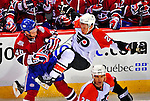 18 December 2008: Philadelphia Flyers' defenseman Ossi Vaananen from Finland is checked by Montreal Canadiens left wing forward Andrei Kostitsyn from Belarusse in the second period at the Bell Centre in Montreal, Quebec, Canada. The Canadiens look to avoid a four-game slide, while the Flyers seek their sixth win in a row. The Canadiens defeated the Flyers 5-2. ***** Editorial Sales Only ***** Mandatory Photo Credit: Ed Wolfstein Photo