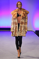 Model walk runway in a fur coat from the Kostas Outerwear collection, by Kostas Gagasoules, during Couture Fashion Week New York, February 18, 2012.