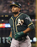 Oakland Athletics  Coco Crisp returns to the dugout  after holding off the  Seattle Mariners in the 11th inning September 13, 2014 at Safeco Field in Seattle. The Athletics beat the Mariners 3-2 when  Mariners pitcher Fernando Rodney walked in Coco Crisp in the 10th inning.  UPI/Jim Bryant