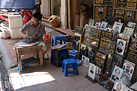 Hanoi<br /> , Vietnam - 2007 File Photo -<br /> <br /> <br /> Hanoi, Vietnam, stone grave craver  and its sidewalk display.<br /> <br /> <br /> photo : James Wong-  Images Distribution