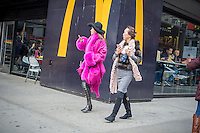 Fashion forward Asian tourists pass a McDonald's restaurant in Midtown Manhattan in New York on Sunday, February 5, 2017. (© Richard B. Levine)