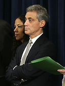 Chicago, IL - November 24, 2008 -- White House Chief-of-Staff Rahm Emanuel stands on the side as United States President-elect Barak Obama introduces his economic team during a news conference on Monday, November 24, 2008 in Chicago. Obama aides on Sunday called on the new congress, which convenes January 6, 2009, to pass legislation consistent with Obama's economic plans..Credit: Brian Kersey - Pool via CNP