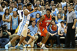 30 December 2015: Clemson's Jaron Blossomgame (5) and North Carolina's Isaiah Hicks (4). The University of North Carolina Tar Heels hosted the Clemson University Tigers at the Dean E. Smith Center in Chapel Hill, North Carolina in a 2015-16 NCAA Division I Men's Basketball game. UNC won the game 80-69.