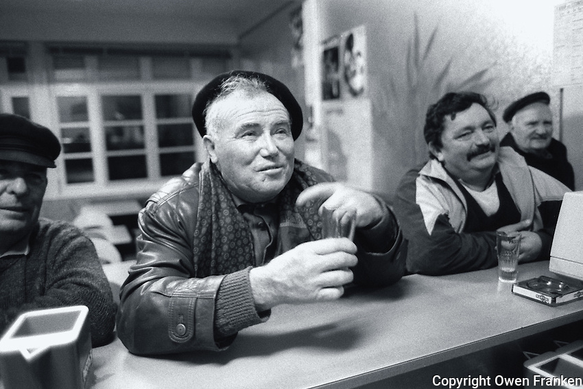 frenchmen at a bar- Photograph by Owen Franken