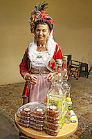 Traditional Corfiot woman in the old town of Corfu, Greece
